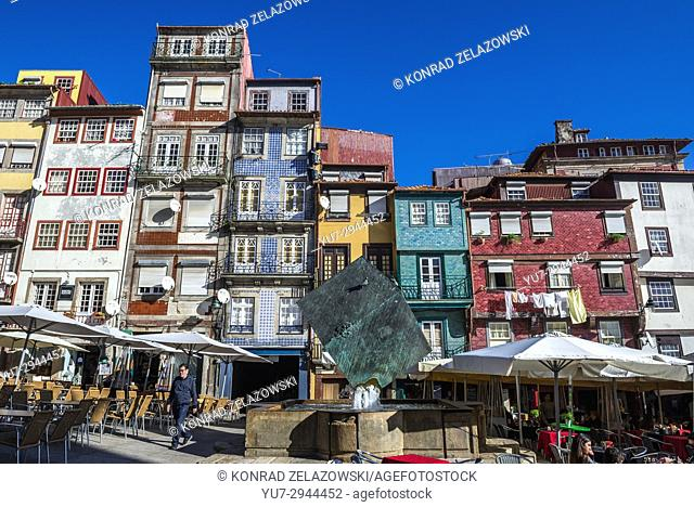 Tenement houses and Cubo da Ribeira modern sculpture by Jose Rodrigues on Ribeira Square in Porto city, second largest city in Portugal