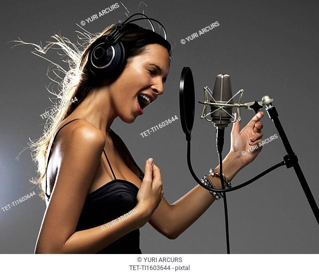 Studio shot of singing rockstar