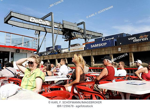 Tourists on the sun deck, harbor cruise at the container terminals, Duisburg-Ruhrorter Haefen, inland port Duisport, Ruhrort, North Rhine-Westphalia, Germany