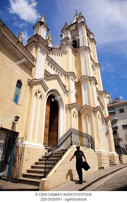 Man in front of the Saint Angel Custodio Church-Iglesia del Santo Angel Custodio at Old Havana district, La Habana, Cuba, West Indies, Central America