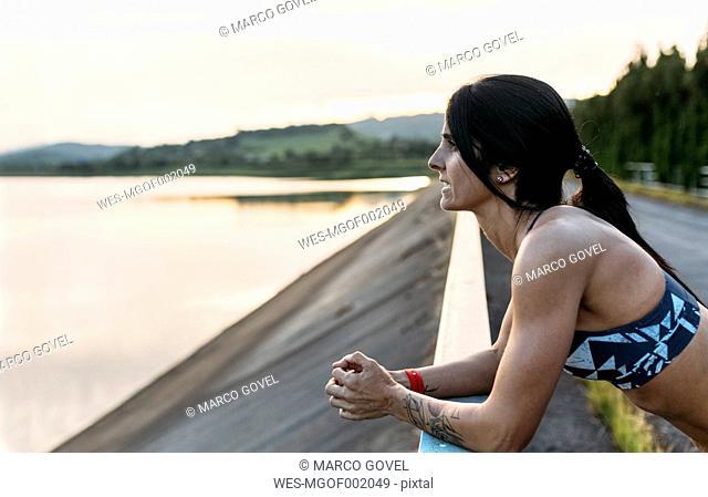 Athlete leaning on railing
