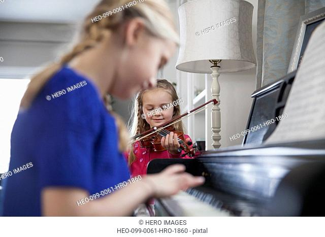 Sisters playing music together