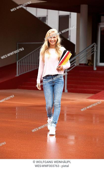 Happy blond teenage girl