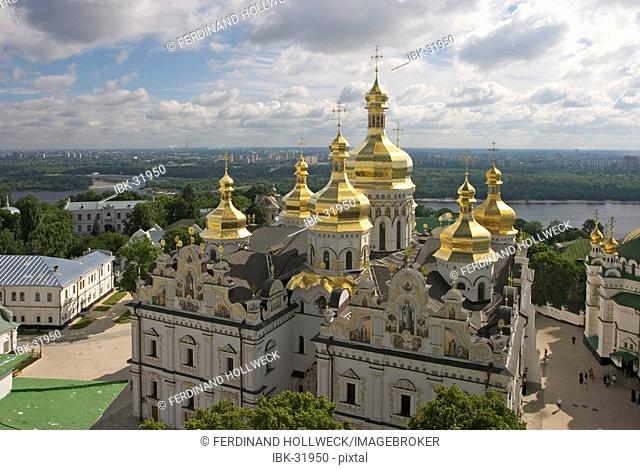 Ukraine Kiev the monastery of cave Kyjevo Pecers'ka Lavra view to Uspens'kyj Cathedral with 7 golden domes crosses blue sky river Dnepr at background 2004
