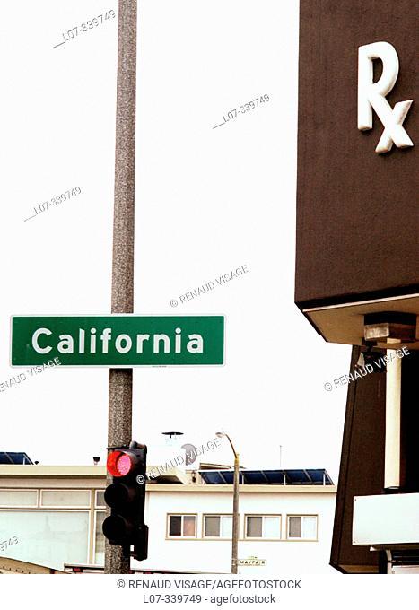 Pharmacy storefront and California street sign. San Francisco, California. USA