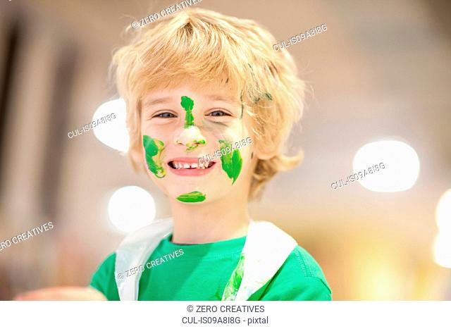 Boy with green paint on his face