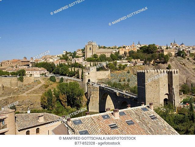 Spain, Castile-La Mancha, Toledo, view of the old fortified city and Puente de San Martín, San Martín Bridge across the Tagus valley