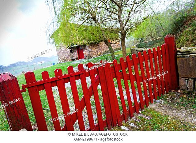 Woman, house and fence