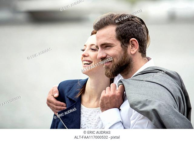 Couple embracing each other outdoors