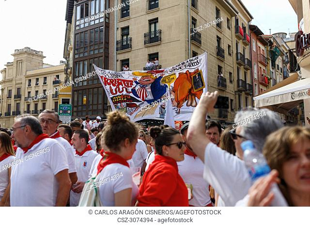 PAMPLONA, SPAIN - JULY 10, 2017: Banner of the group of friends Irrintzi, with a cartoon of donald trump. Political satire of the most important events of the...