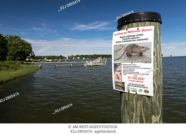 Fairbank, Maryland - A poster at a dock on the Chesapeake Bay asks residents to report signs of the invasive nutria