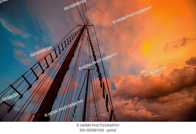 Mast of old dutch schooner sailboat against evening sky, Komodo Island, East Nusa Tenggara, Indonesia