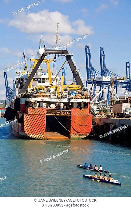 Canoers in Panama Canal pass container ship at Balboa Port, Panama