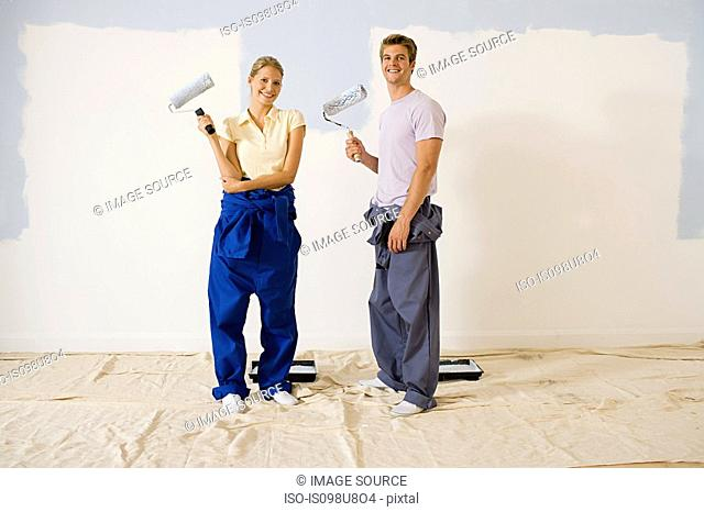 Young couple decorating