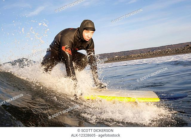 Man surfing, South-central Alaska; Homer, Alaska, United States of America