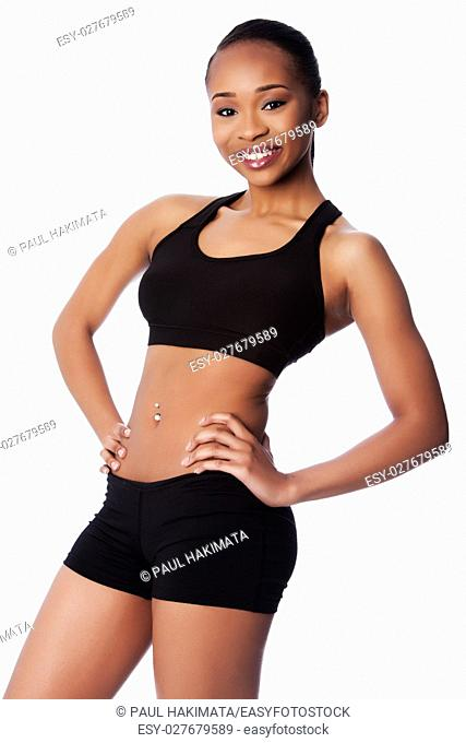 Beautiful healthy fit happy smiling black asian woman workout and toned body