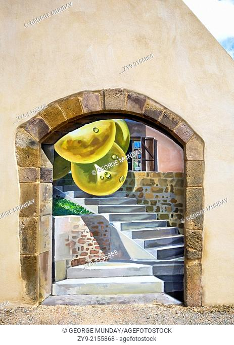 Surrealistic mural with Giant grapes and steps at Cebazan, Languedoc-Roussillon, France