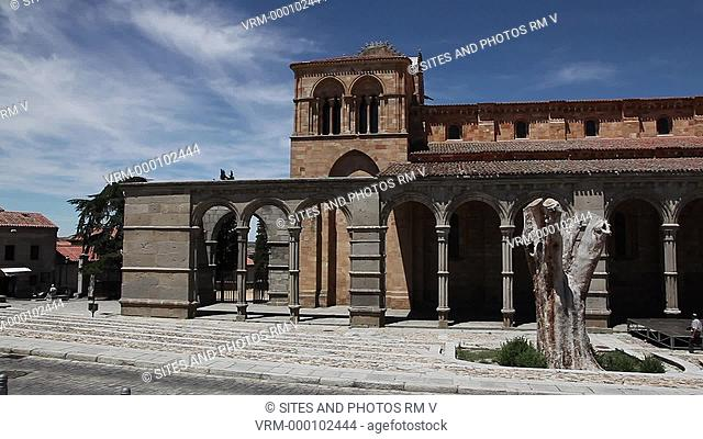 PAN, LA, Daylight. Exterior, south porch. Erected between the 11th and 14th centuries, the basilica preserves the west porch in Romanesque design
