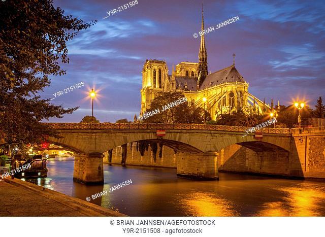 Twilight over Cathedral Notre Dame along River Seine, Paris, Ile-de-France, France