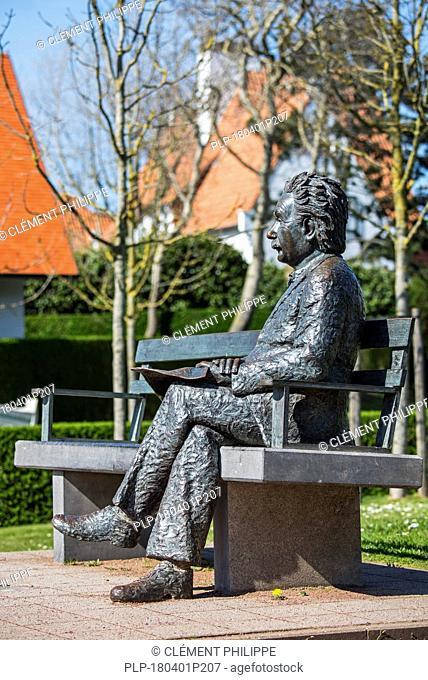 Albert Einstein statue sitting on a park bench at the seaside resort De Haan / Le Coq, West Flanders, Belgium