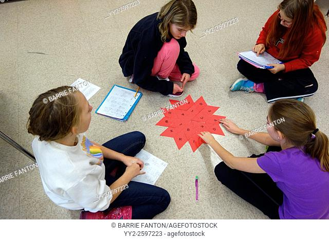 6th Grade Girls Solving Math Problem, Wellsville, New York, United States