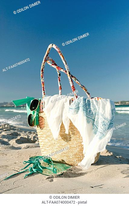 Packed beach bag on beach