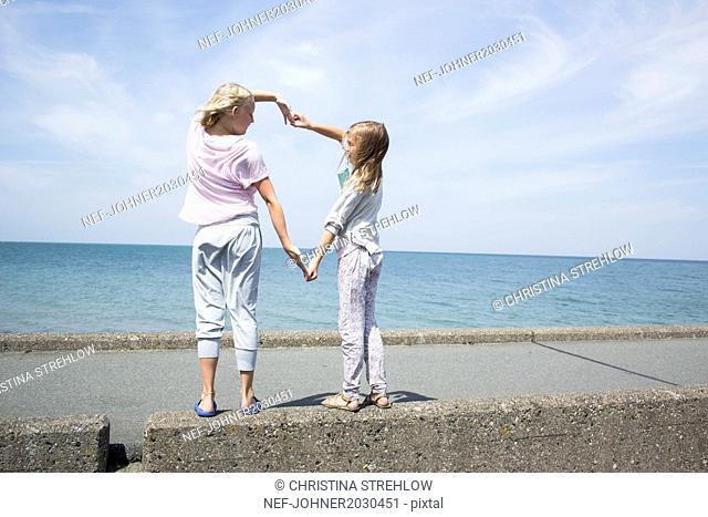 Girls playing at sea