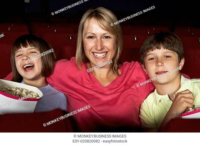 Mother Watching Film In Cinema With Two Children