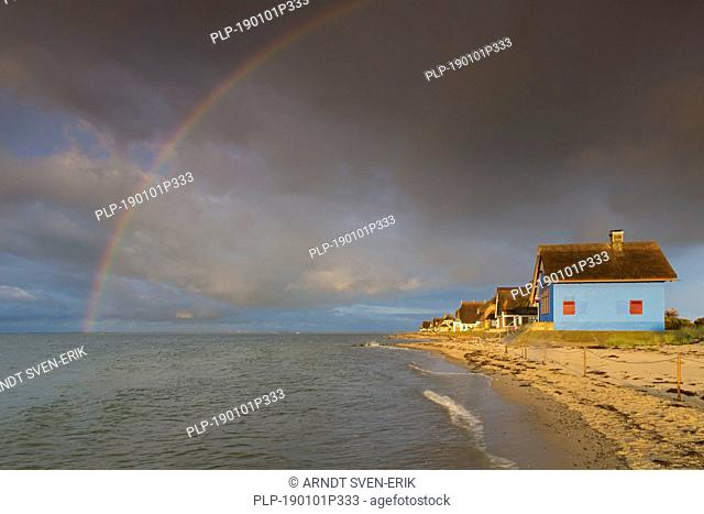 Rainbow and beach houses on the peninsula Graswarder, Heiligenhafen, Schleswig-Holstein, Germany