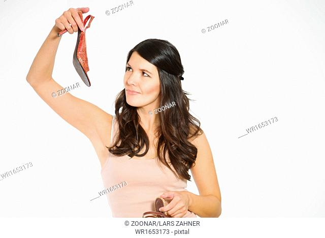 Fashionable woman choosing a pair of shoes