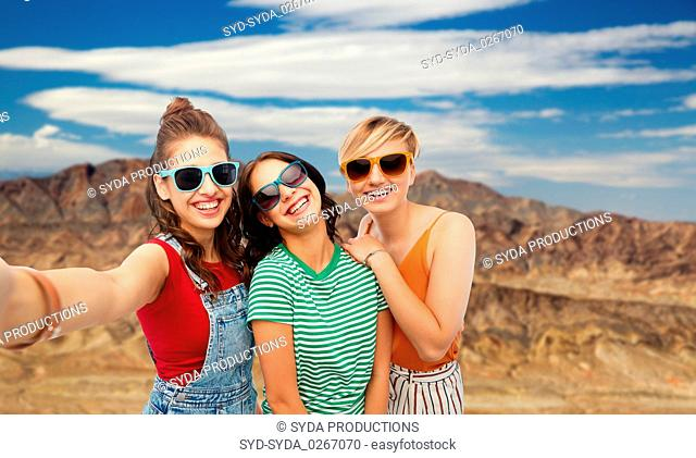 female friends taking selfie over grand canyon
