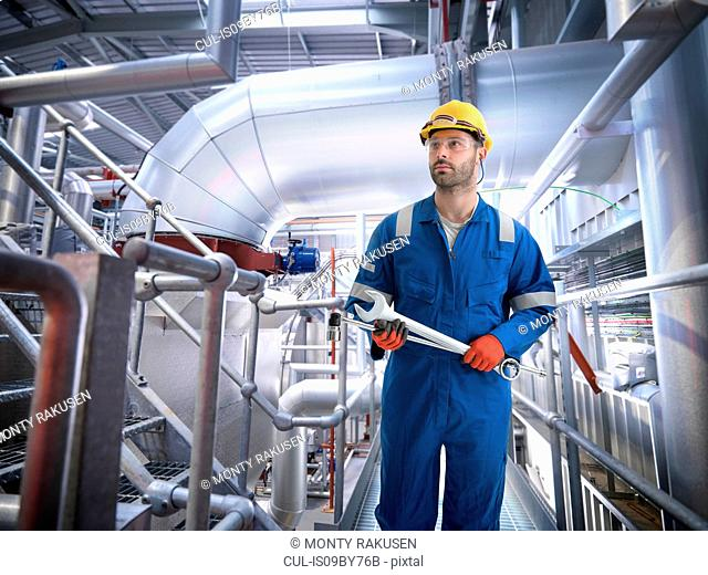 Composite image of engineer in gas power station