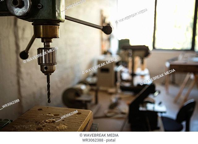 Close-up of wood drilling machine
