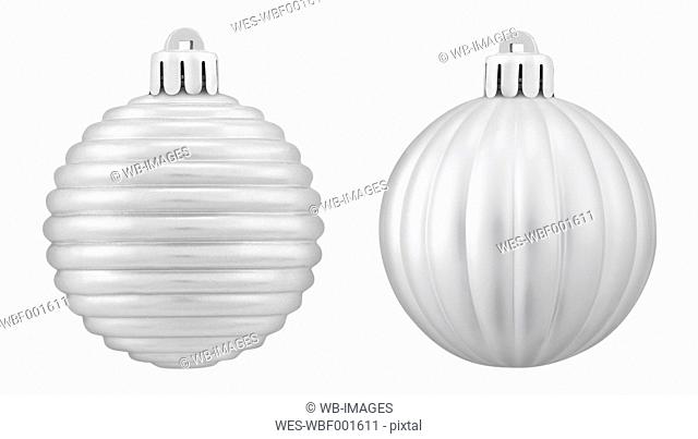 Two silver christmas bauble against white background, close up