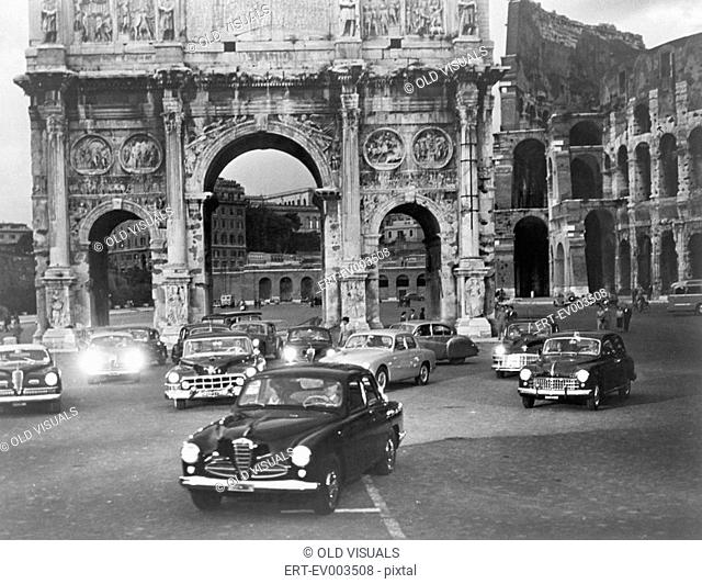 Cars and ancient monuments Rome Italy All persons depicted are not longer living and no estate exists Supplier warranties that there will be no model release...