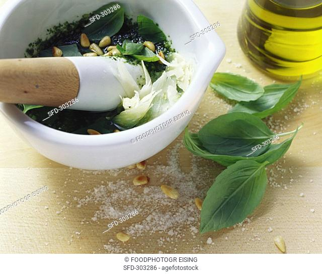 Pesto ingredients in a mortar