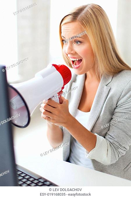 picture of crazy businesswoman shouting in megaphone