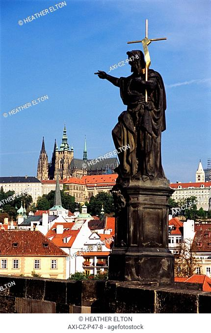 Statue on Charles Bridge with Hradcany in background