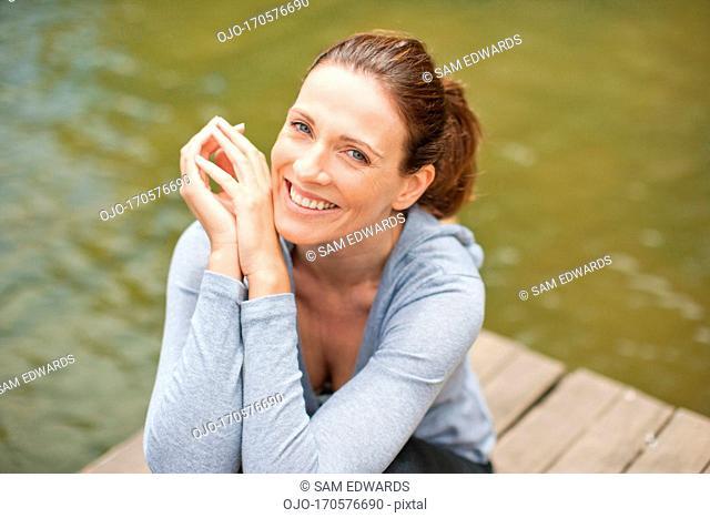 Woman on pier by lake