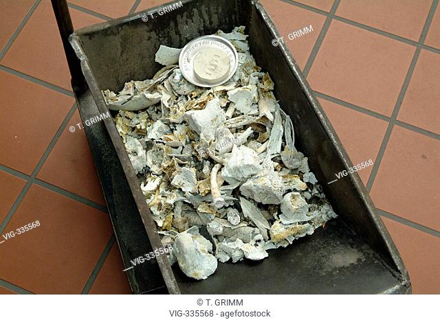 Cremation in Hamburg crematorium on the cemetery Hamburg Oejendorf. The picture shows the remaining human ashes with a numbered identification stone