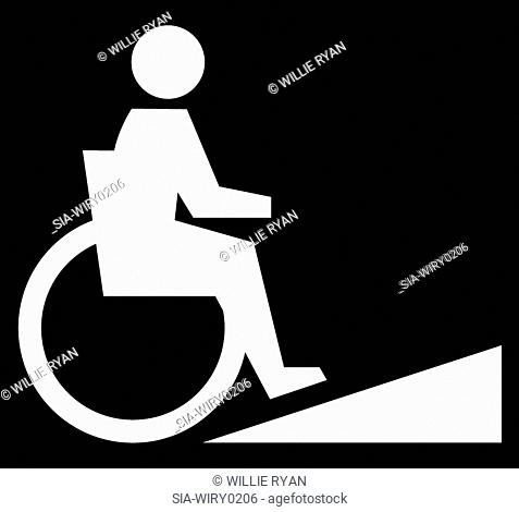 Person in wheelchair moving up ramp