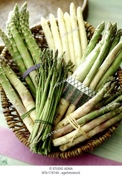 Still life with various types of asparagus in a basket