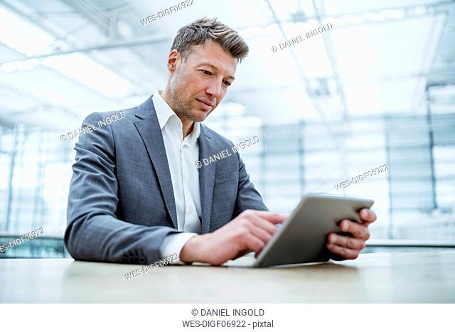 Businessman using tablet at table