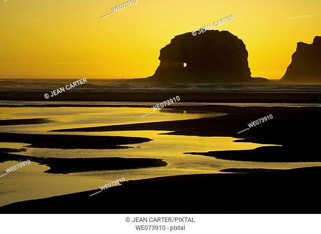 Twin Rocks at sunset near Rockaway Beach. Northern Oregon coast, USA