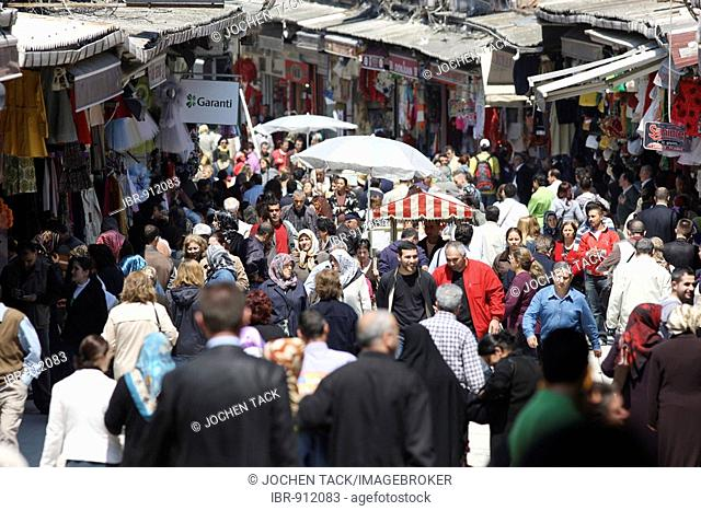 Bazaar district, shopping street near the Grand Bazaar or Covered Bazaar filled with people, Istanbul, Turkey