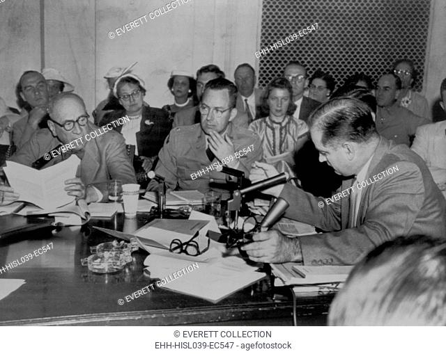Senator Joseph McCarthy (right) demands an apology from Army Counsel Joseph Welch (left). June 15, 1954. In between them is Lt. Col. John F. T