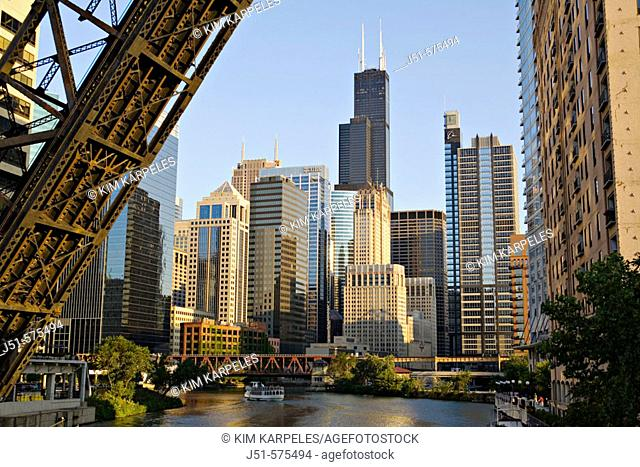 Illinois. Chicago. Chicago River in downtown loop area of city, permanently upraised bridge over river, old railroad bridge, tour boat