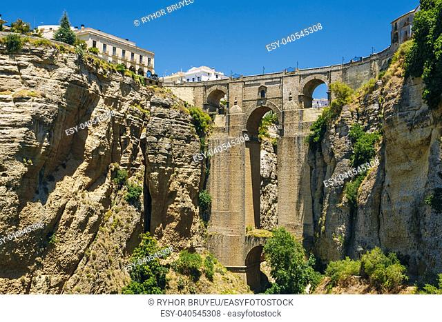 The New Bridge (Puente Nuevo) is the 120-metre (390 ft)-deep chasm that carries the Guadalevin River and divides city of Ronda, Province Of Malaga, Spain