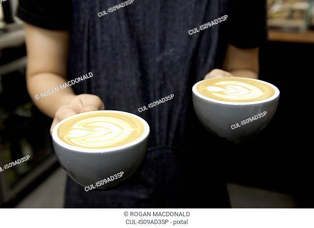 Barista serving cappuccino