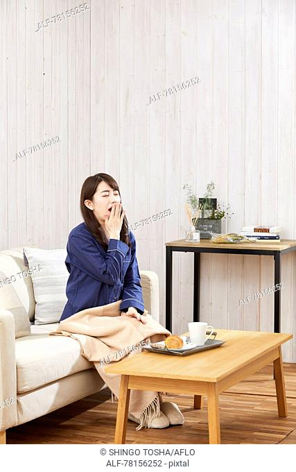 Japanese woman eating in a pajamas